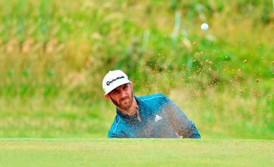 Dustin Johnson hits a bunker shot during a practice round ahead of today's Open Championship first round at Troon. Picture Credit: Stuart Franklin/Getty Images