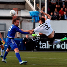 Brian Gartland has his shirt tugged by Davíd Vidarsson of FH Hafnarfjordur at Oriel Park. Photo: Sportsfile