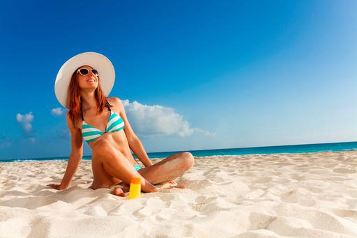 'Apply high-factor sunscreen early on and regularly. It is important to apply sunscreen at least 20 minutes before going out in the sun' (stock photo)