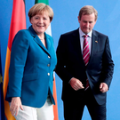Enda Kenny and Angela Merkel at their non-meeting of minds in Berlin on Tuesday. Photo: AP/Markus Schreiber