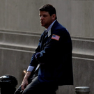 A trader takes a break outside the New York Stock Exchange Photo: Brendan McDermid / Reuters