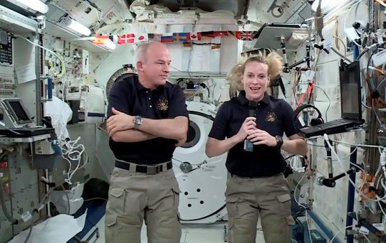 Astronaut Kate Rubins, right, speaks during an interview aboard the International Space Station on Wednesday. (NASA via AP)