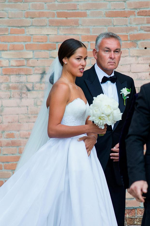 Ana Ivanovic and her father Miroslav Ivanovic enter to the church for the wedding to Bastian Schweinsteiger on July 13, 2016 in Venice, Italy. (Photo by Awakening/Getty Images)