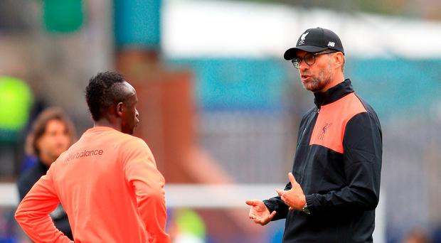 Liverpool's manager Jurgen Klopp (right) talks to Sadio Mane before the pre-season match last week