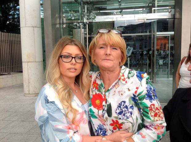 Rose Kenny (right) leaving court with her daughter Jamie (left)