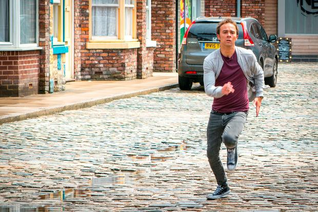 David Platt (Jack P. Shepherd) running to his wife Kylie Platt (Paula Lane) who shortly after dies in his arms. Photo: Mark Bruce/ITV/PA Wire
