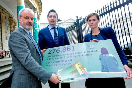 Amnesty Ireland's Executive Director Colm O'Gorman with Minister Simon Harris and Sorcha Tunney, Amnesty International My Body My Rights Campaigns Officer