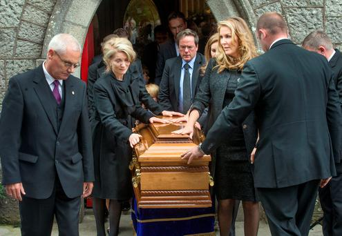 Joe Hayes' widow Collette with son Colin (rear) and daughter Danielle (right) at his funeral in Blessington. Photo: Tony Gavin