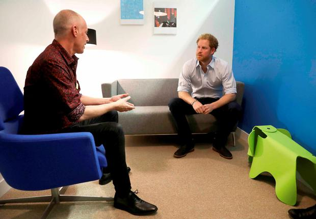 Prince Harry chats with Specialist Psychotherapist Robert Palmer in a councelling room as visits Burrell Street Sexual Health Clinic in London, Britain on July 14, 2016. REUTERS/Chris Jackson/Pool