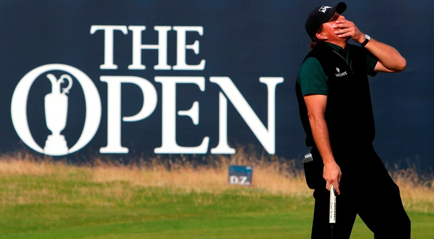 Phil Mickelson reacts to a missed putt on the final hole which denied him the chance become the first player in history to shoot a Major round of 62. Photo: Peter Byrne/PA Wire.
