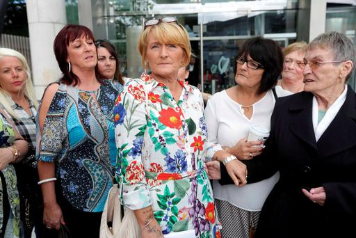 Rose Kenny (centre) is surrounded by family and friends as she leaves the Central Criminal Court. Photo: Collins Courts