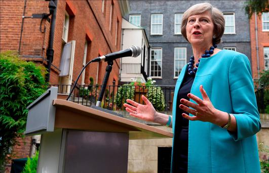 British Prime Minister Theresa May hosts a reception for the Police Bravery Awards in the Garden of Number 10 Downing Street. Photo: Getty