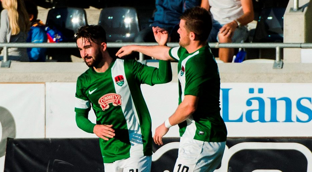 Cork City's Sean Maguire celebrates with team-mate Steven Beattie after scoring his side's first goal. Photo: Mathias Bergeld /Sportsfile