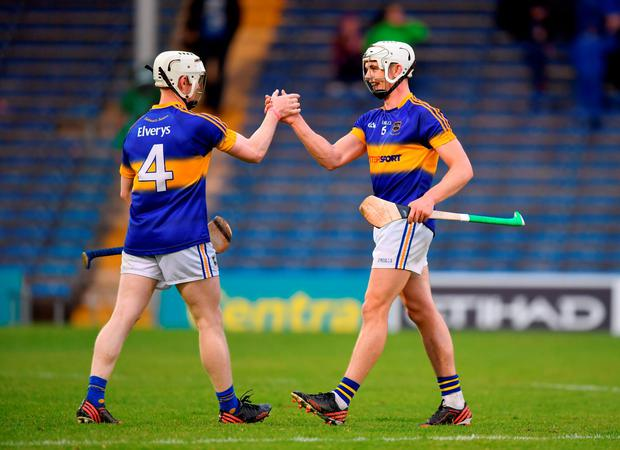 Tipperary's Ronan Maher and David Sweeney celebrate their side's victory during the Bord Gáis Energy Munster U21 Hurling Championship Semi-Final. Photo: Stephen McCarthy/Sportsfile