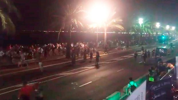 Twitter feed video grab courtesy of @harp_detectives of people running away after dozens of people are believed to have been killed when a lorry ploughed into a Bastille Day crowd in Nice. @harp_detectives/PA Wire