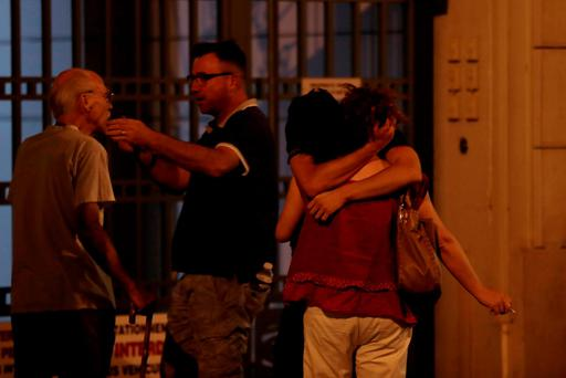 People react after the tragedy. AFP/Getty Images