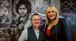 Award-winning photographer Arthur Carron with Miriam O'Callaghan at the opening of his exhibition at CHQ Building. Photo: Doug.ie