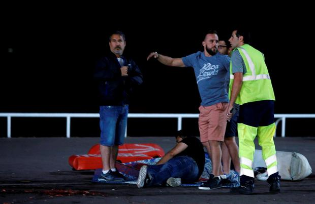 An injured individual is seen on the ground. Photo: Reuters