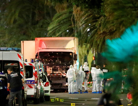 Police and forensic officers gather around the truck, whose windscreen was was riddled by bullets from police. Photo: Reuters