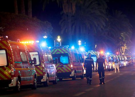 Ambulances line up near the scene of the attack. (AP Photo/Claude Paris)