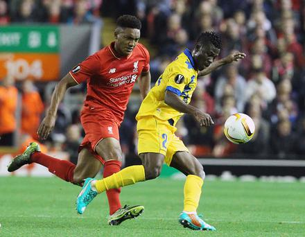 LIVERPOOL, ENGLAND - OCTOBER 1: Liverpool's midfielder Joe Gomez (L) vies with Sion's striker Ebenezer Assifuah during the Europa League Group B soccer match between Liverpool FC and FC Sion at the Anfield Stadium in Liverpool, north west England on October 1, 2015. (Photo by Lindsey Parnaby/Anadolu Agency/Getty Images)