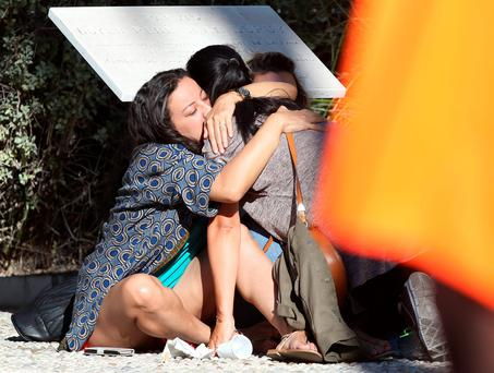 Parents of victims embrace each other near the scene of a truck attack in Nice, southern France. (AP Photo/Luca Bruno)
