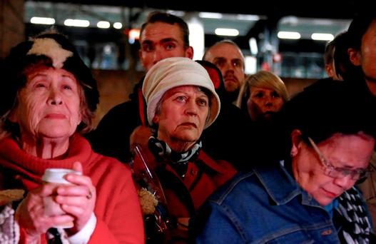 Members of the Australian French community reacts during a minute of silence during a vigil in central Sydney, Australia, July 15, 2016 to remember the victims of the Bastille Day truck attack in Nice. REUTERS/David Gray