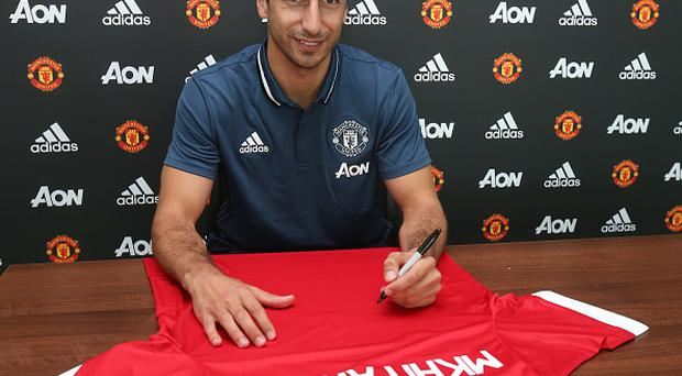 MANCHESTER, ENGLAND - JULY 06: (EXCLUSIVE COVERAGE) Henrikh Mkhitaryan of Manchester United after signing for the club at Aon Training Complex on July 6, 2016 in Manchester, England. (Photo by Matthew Peters/Man Utd via Getty Images)