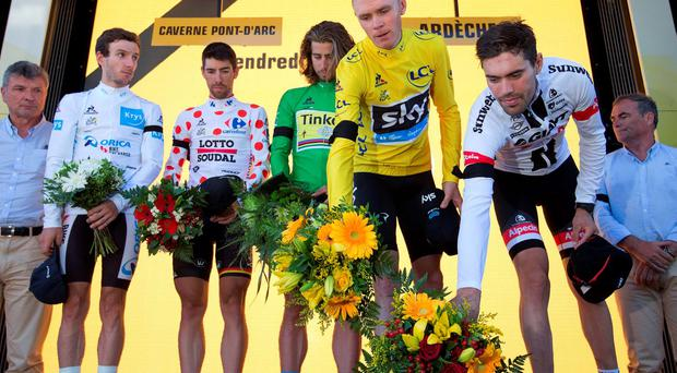 Britain's Adam Yates, wearing the best young rider's white jersey, Belgium's Thomas de Gendt, wearing the best climber's dotted jersey, Peter Sagan of Slovakia, wearing the best sprinter's green jersey and Britain's Chris Froome, wearing the overall leader's yellow jersey