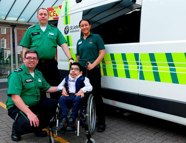 Sultan Ali (front right), 16, with John Ambulance volunteers, as the teenager with a life-limiting condition arrived at his school prom in an ambulance - after asking hospital staff to make sure he could join his classmates. Credit: St John Ambulance/PA Wire