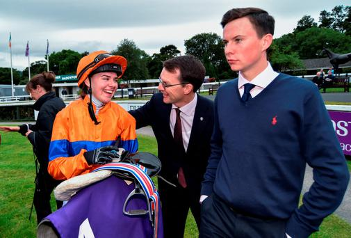 Joseph O'Brien seems deep in thought as his sister Ana is congratulated by their father Aidan after her victory aboard Arya Tara in the Stanerra Stakes at Leopardstown. Photo: Cody Glenn/Sportsfile