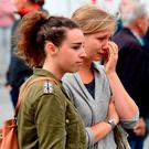 A young woman cries as she stands in front of the French Embassy in Berlin, after the deadly attacks in Nice. Photo: AFP/Getty Images