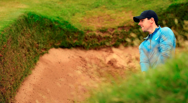 Rory McIlroy plays from a green-side bunker on the eighth hole during yesterday's second round of The Open. Photo: Glyn Kirk/AFP/Getty Images