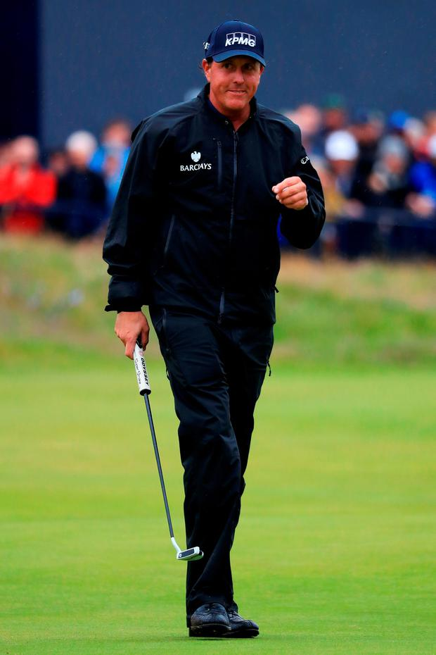 Phil Mickelson acknowledges the crowd after putting on the 18th green. Photo: Matthew Lewis/Getty Images