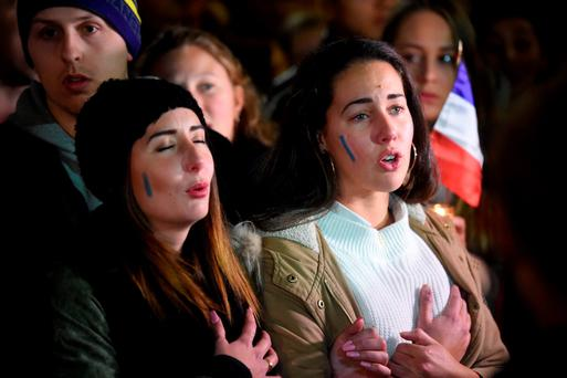 Members of the French community hold a vigil in Sydney. AFP/Getty Images