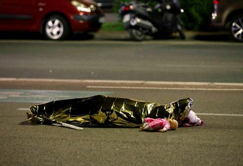 A doll lies beside a body in the aftermath of the Nice attack. Photo: REUTERS/Eric Gaillard