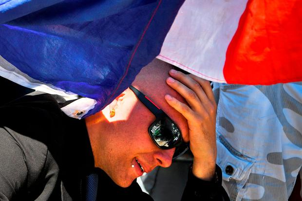 A man mourns in Nice. Photo by David Ramos/Getty Images