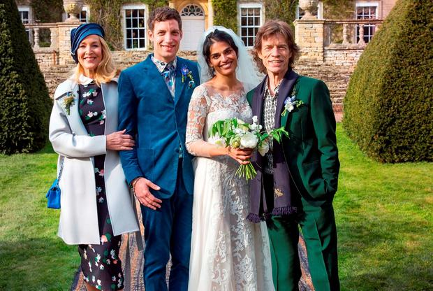 Mick Jagger with his son James Jagger at his wedding to Anoushka Sharma (centre) with his ex-partner Jerry Hall (left)