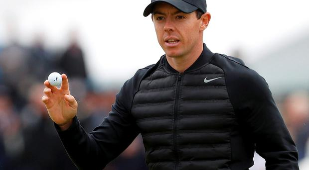 Rory McIlroy acknowledges the crowd after birdie on the fourth hole