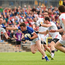 Tomas Corr of Cavan is tackled by Ronan McNabb, left, and Justin McMahon of Tyrone during the Ulster GAA Football Senior Championship Semi-Final replay