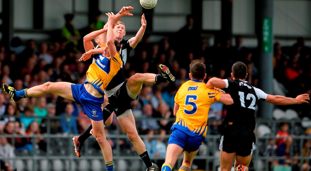 Cathal O'Connor of Clare in action against Adrian McIntyre and Adrian Marren of Sligo