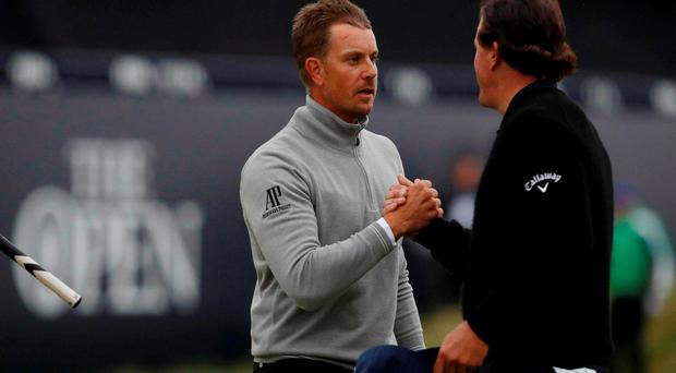 Phil Mickelson shakes hands with Sweden's Henrik Stenson on the 18th green