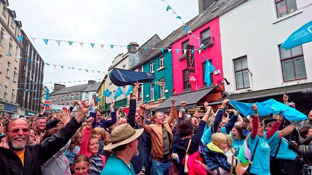 JUBILATION: Locals take to the streets to celebrate after Galway was announced as the European Capital of Culture 2020, after it successfully beat off the challenge of Limerick and the 'Three Sisters' region of Kilkenny, Waterford and Wexford