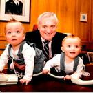 Bertie Ahern in 2008, when he was Taoiseach, in his office with his twin grandsons Rocco and Jay. Photo: David Conachy.