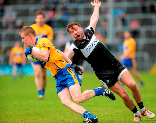 Clare's Pearse Lillis in action against Sligo's Daniel Maye. Photo by Oliver McVeigh/Sportsfile