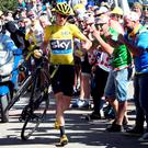 Chris Froome running up Mont Ventoux after an accident caused by the vastness of the crowds had damaged his bike beyond use. Photo: Bernard Papon