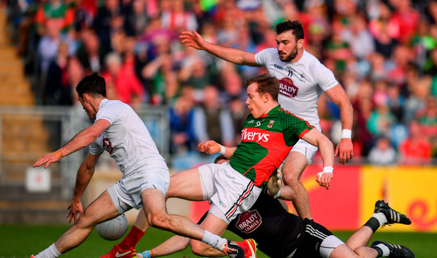 Donal Vaughan of Mayo in action against Kildare players, from left, Eoin Doyle, Mark Donnellan and Fergal Conway