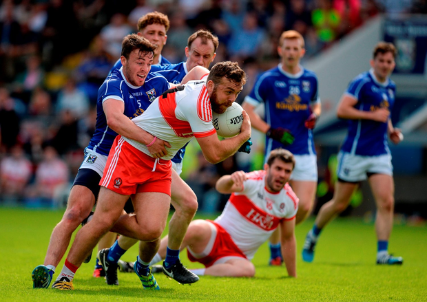 Derry's Emmett McGuckin tries to escape the grasp of Conor Moynagh. Photo by Brendan Moran/Sportsfile