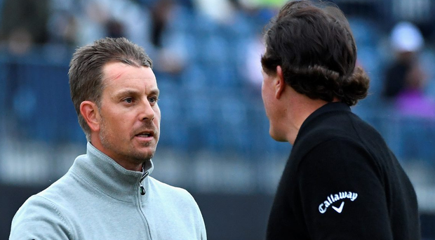 Henrick Stenson and Phil Mickelson shake hands on the 18th at Royal Troon yesterday. Photo: Getty Images