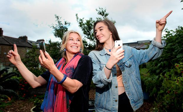 BIG HUNT GAMERS: Carol Hunt and daughter Sophie about to get nose-deep in their phones as they set off Pokemoning. Photo: Gerry Mooney